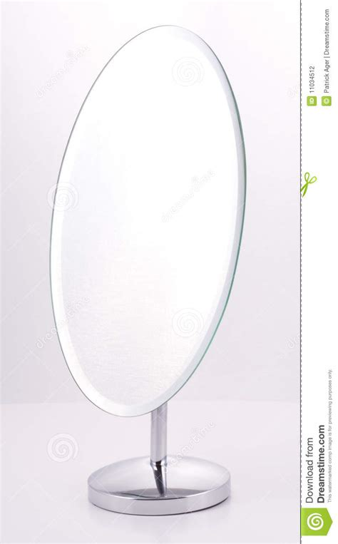 White Bathroom Vanity With Top by Chrome Oval Mirror With Stand Stock Photography Image