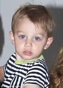 John Travolta's blue-eyed boy Benjamin clings to his ...