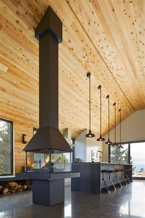 expansive quebec residence charms  inviting warmth  wood