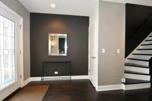 the hardwood floor matching stairs grey walls and white door for sale in chicago