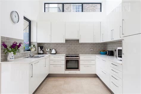 gray ovens with grey metro tile splashback kitchen modern