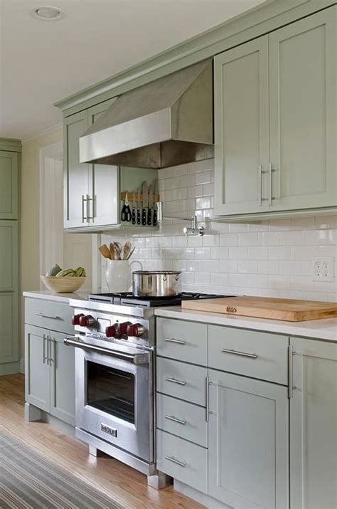green and white kitchen cabinets sage green kitchen walls design ideas 368 | sage green cabinets white quartz countertops magnetic cooktop knife rack