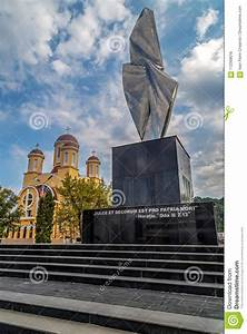 Monument And Orthodox Church In Resita  Romania  Editorial Photo