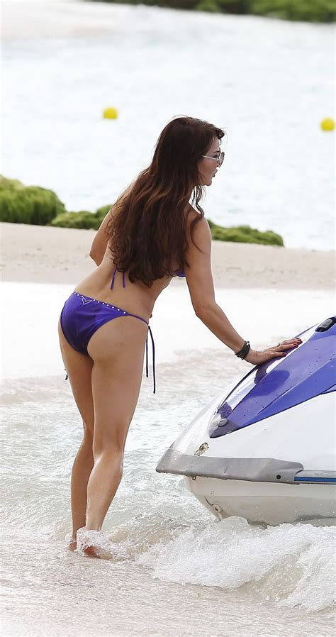 Lizzie Cundy busty wearing skimpy purple bikini at the beach in Barbados