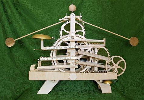 wooden gear clock plans  clayton boyer  celebration rolling ball clock woodworking