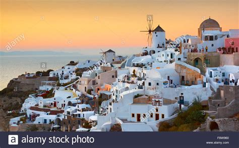 Santorini View Of Oia Town And Windmills At Sunset Time
