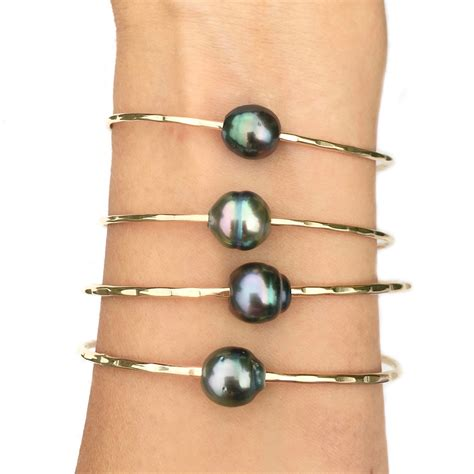Aa Tahitian Pearl Bangle Bracelet  Kailua Jewelry. Semi Precious Gemstone Beads. Navy Bracelet. Smart Phone Watches. Horizontal Bar Necklace. Hole Rings. Chunky Gold Bangle. Graff Diamond Earrings. Nickel Allergy Earrings