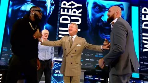 Deontay Wilder shoves Tyson Fury as both fighters try to ...
