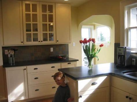kitchen pale yellow white cabinets black granite