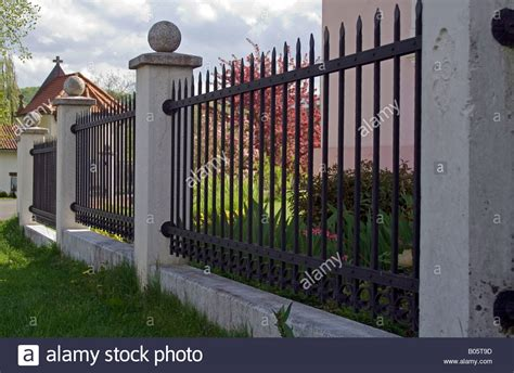 front yard metal fences iron fence in the front yard and around the house stock photo royalty free image 17339209 alamy