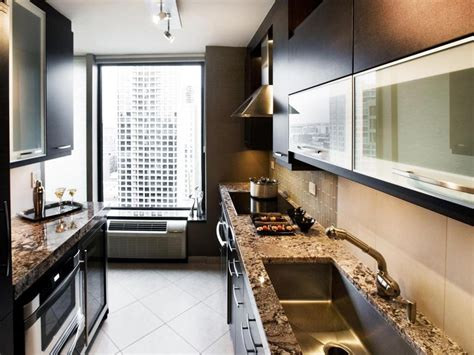Mini wine racks hold up ceiling skimming shelves, a glass mixing bowl doubles as a fresh egg holder, and a water jug sidelines as cooking utensil storage. 25 Modern Small Kitchen Design Ideas
