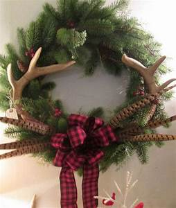 Christmas wreath with deer antlers and pheasant feathers ...