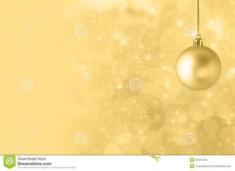 yellow christmas bauble  starry bokeh background stock