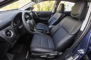 2018 Toyota Corolla SE front interior seats - Motortrend