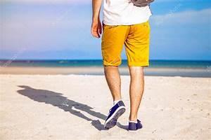 Stylish man walking alone the beach — Stock Photo #75373999