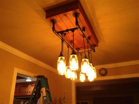 iron pipe light fixture wanted to work with iron pipe mason jars and cloth wire