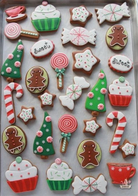 pictures of decorated christmas cookies using royal icing and green cutout cookies with royal frosting inspired by stickers haunted