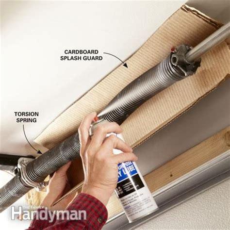 how to lubricate garage door how to fix a noisy garage door the family handyman