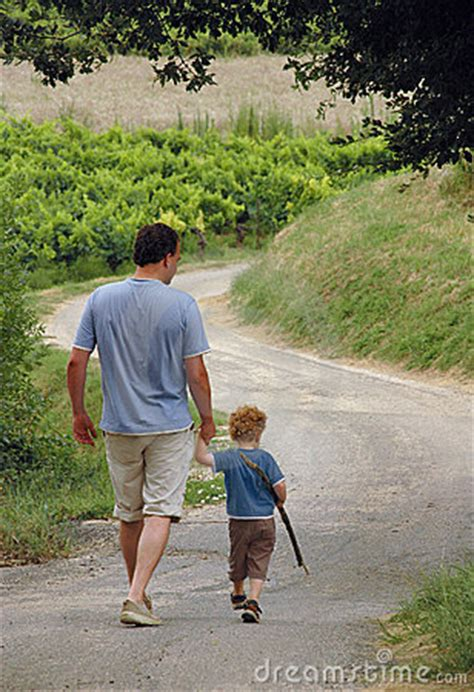 father  son walking royalty  stock photography