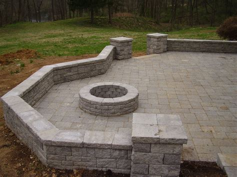 Patio With Seat Wall Columns And Fire Pit.