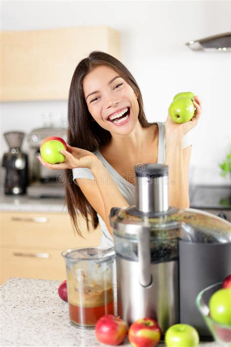 healthy green kitchen apple juice on juicer machine at home in kitchen stock 1597