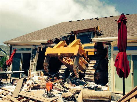 bulldozer plows  home  denvers green valley ranch