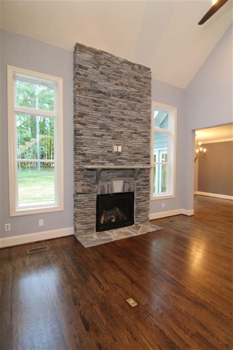 Two story fireplace surround - Transitional - Living Room