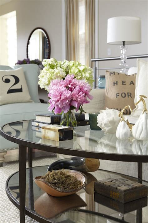 A living room without a coffee table is a lot like a supermodel without lipstick, undone. Oval Coffee Table - Cottage - living room - Jillian Harris