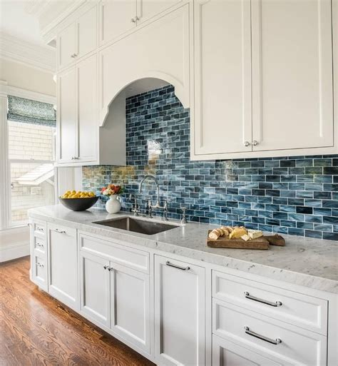 blue backsplash kitchen white and blue kitchen features white shaker cabinets 1721