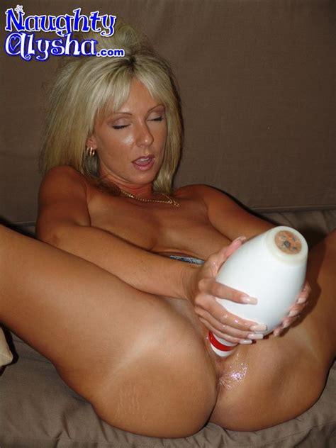Tanned Blonde Milf Wearing Dark Top And Den XXX Dessert Picture