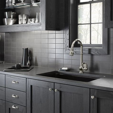 ceramic subway tile kitchen backsplash savoy ceramic subway tile backsplash in graphite in this dark and bold kitchen with dark walnut
