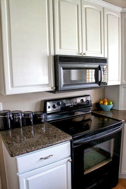 painted kitchen cabinets with black appliances 25 best ideas about kitchen black appliances on 9052