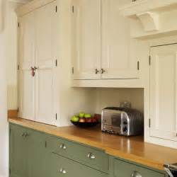 cupboards step inside this traditional muted green kitchen housetohome co uk