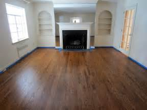 garden city old floors refinished with nutmeg stain and