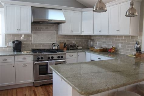 this kitchen features coast green granite countertops and