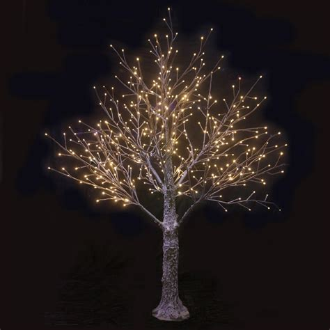brown snowy twig tree white led lights indoor outdoor