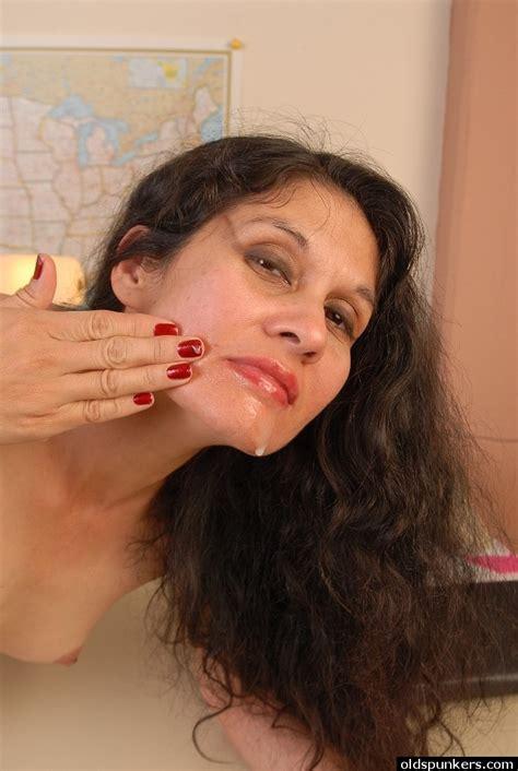 Older Brunette Office Worker Carmen Rubbing Jism On Face