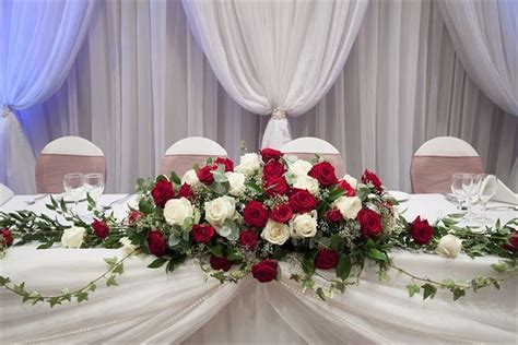 red  ivory rose top table spray arrangement