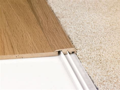 installing transition laminate flooring to carpet finishing how can i hide the gap at the base of the