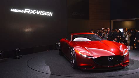 mazda rotary engine returning    ev range extender