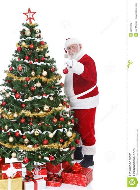 santa claus decorating christmas tree stock photo image