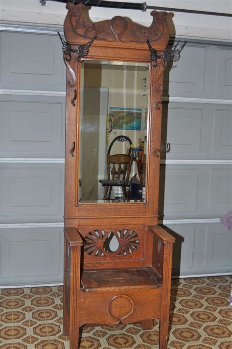 antique oak entry tree with storage bench beveled