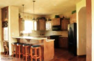 top of kitchen cabinet decor ideas creative juices decor decorating the top of your kitchen cabinets a few tips and tricks