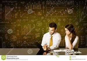 Business Couple With Diagram Background Stock Photo
