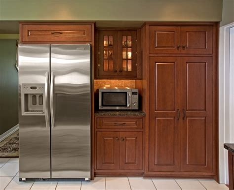 design of kitchen cabinets pictures view of redesigned refrigerator area featuring an 8645