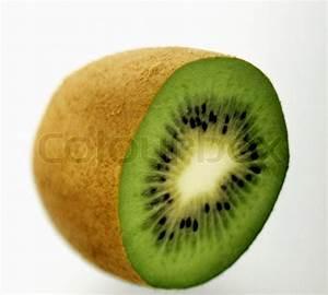 Half a kiwi fruit over white | Stock Photo | Colourbox