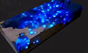 "Mesmerizing resin table illuminates a ""Starry Sea"" with"