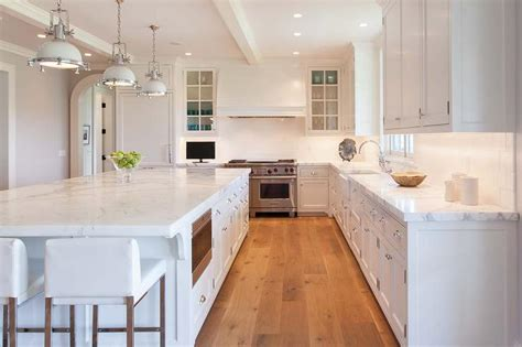 kitchens with hardwood floors and white cabinets white kitchen with white industrial island pendants 770 | white industrial pendants kitchen white oak wood floor