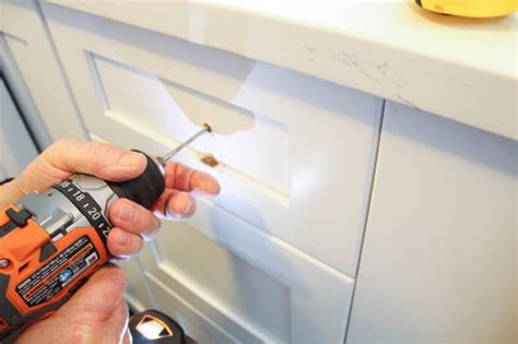 installing drawer pulls how to install cabinet knobs with a template a trick for