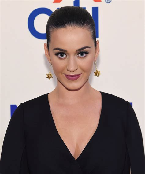 Katy Perry Launches Holiday Onesie Collections| Instyle.com